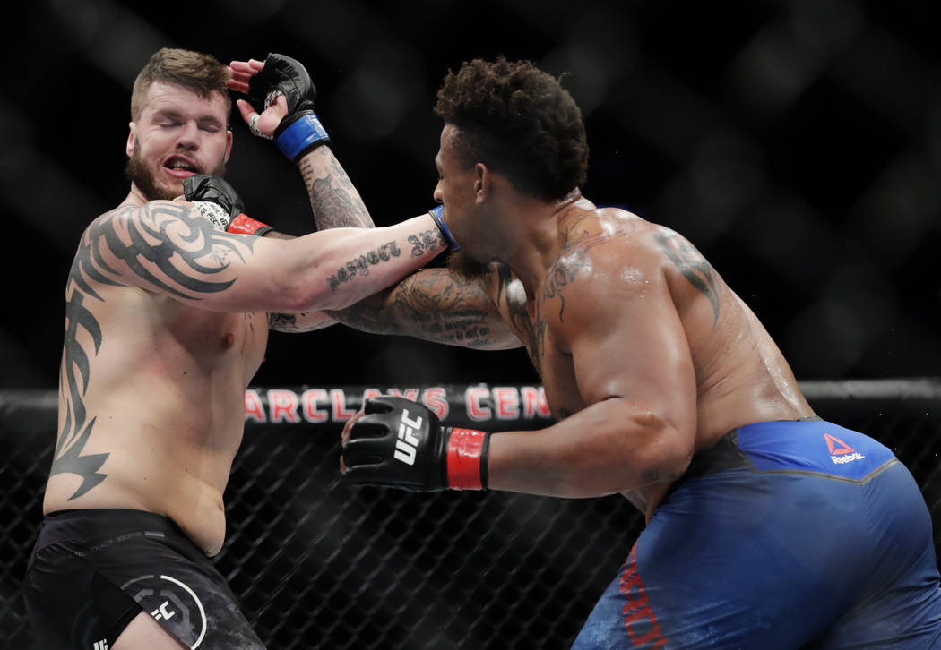 Greg Hardy, right, punches Allen Crowder during the second round of a heavyweight mixed martial arts bout at UFC Fight Night on Saturday, Jan. 19, 2019, in New York. Crowder won the fight after Ha ...