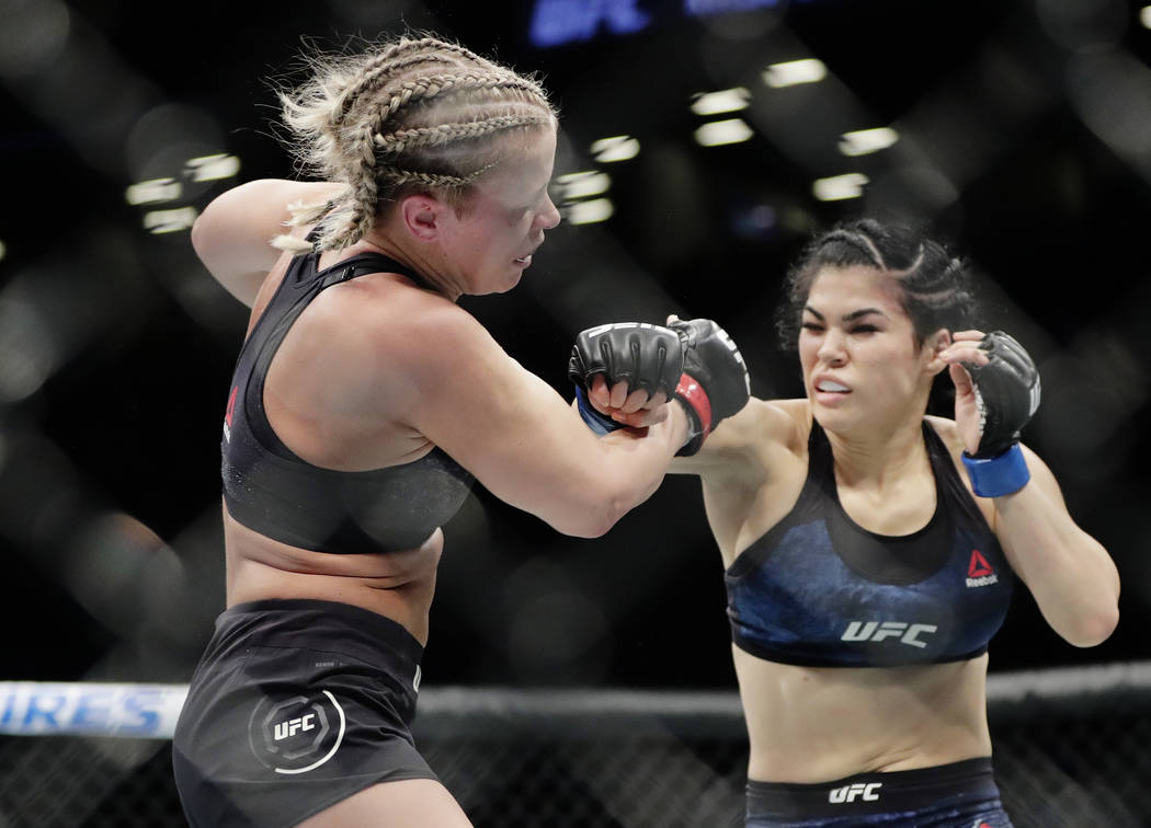 Rachael Ostovich, right, punches Paige VanZant during the first round of a women's flyweight mixed martial arts bout at UFC Fight Night Saturday, Jan. 19, 2019, in New York. VanZant stopped Ostovi ...