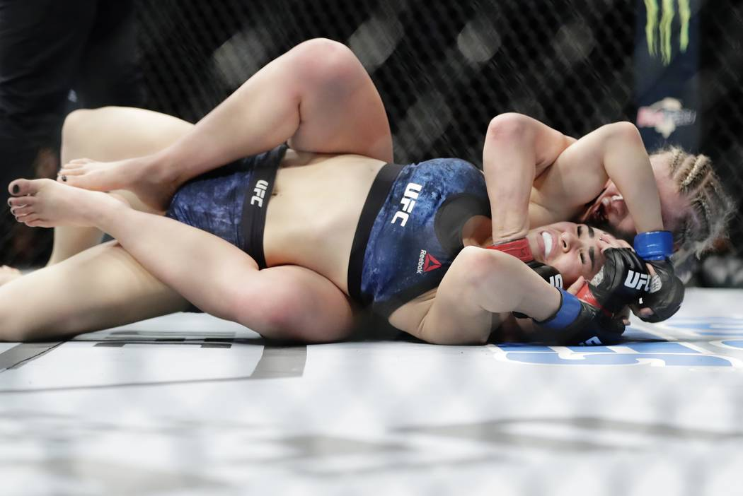 Paige Vanzant, right, wrestles with Rachael Ostovich during the second round of a women's flyweight mixed martial arts bout at UFC Fight Night Saturday, Jan. 19, 2019, in New York. Vanzant stopped ...