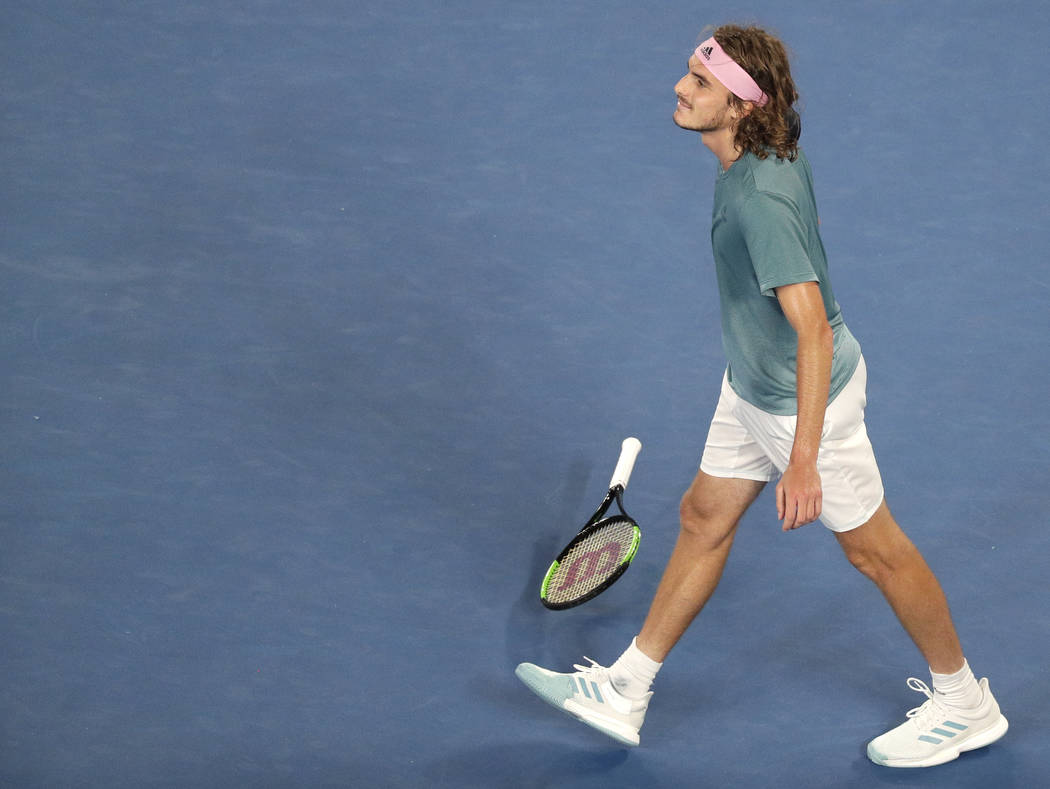 Greece's Stefanos Tsitsipas celebrates after defeating Switzerland's Roger Federer in their fourth round match at the Australian Open tennis championships in Melbourne, Australia, Sunday, Jan. 20, ...
