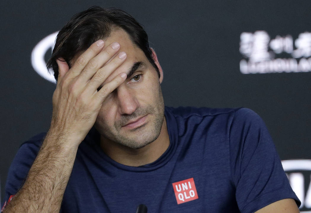 Switzerland's Roger Federer answers questions at a press conference following his fourth round loss to Greece's Stefanos Tsitsipas at the Australian Open tennis championships in Melbourne, Austral ...