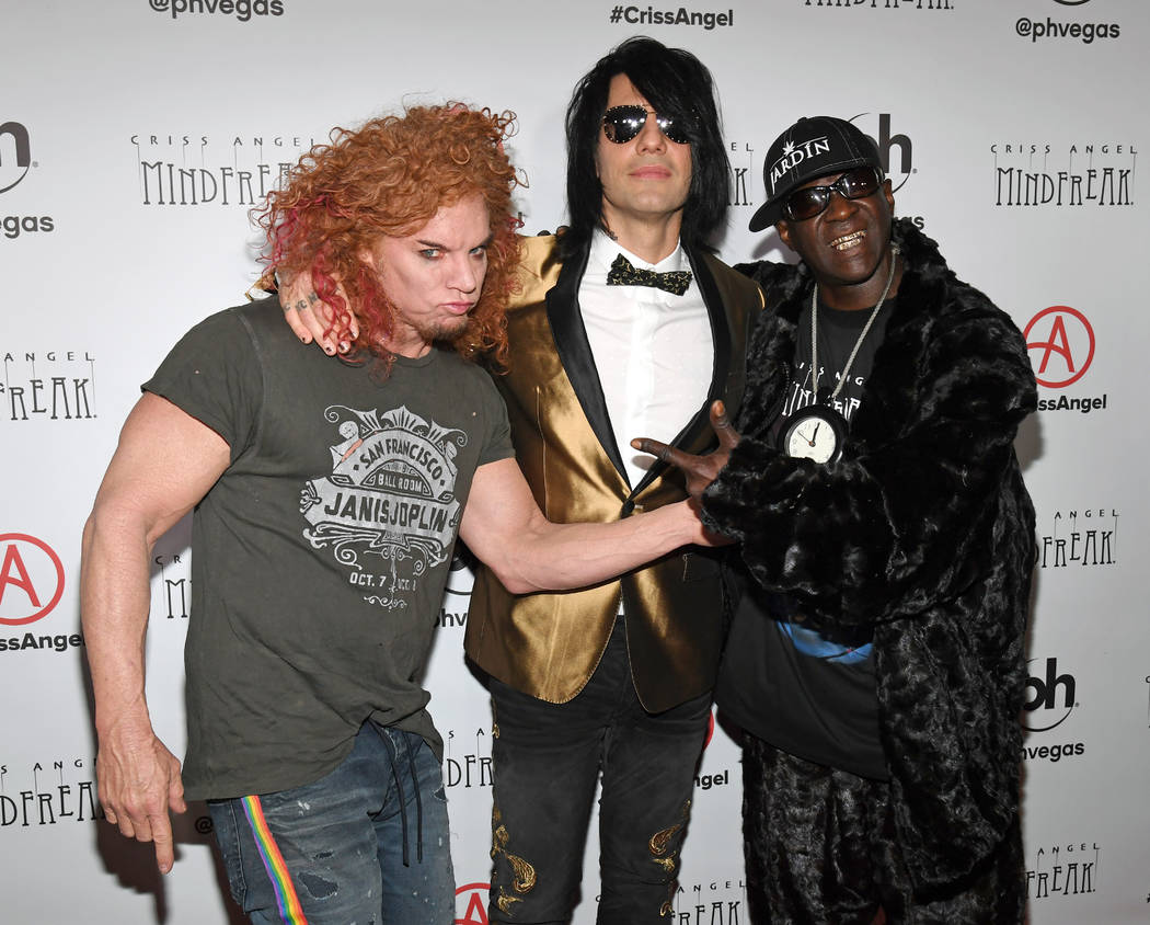 """(L-R) Comedian Carrot Top, illusionist Criss Angel and rapper Flavor Flav attend the grand opening of """"Criss Angel MINDFREAK"""" at Planet Hollywood Resort & Casino on January 19, 2019 in Las Vegas, ..."""