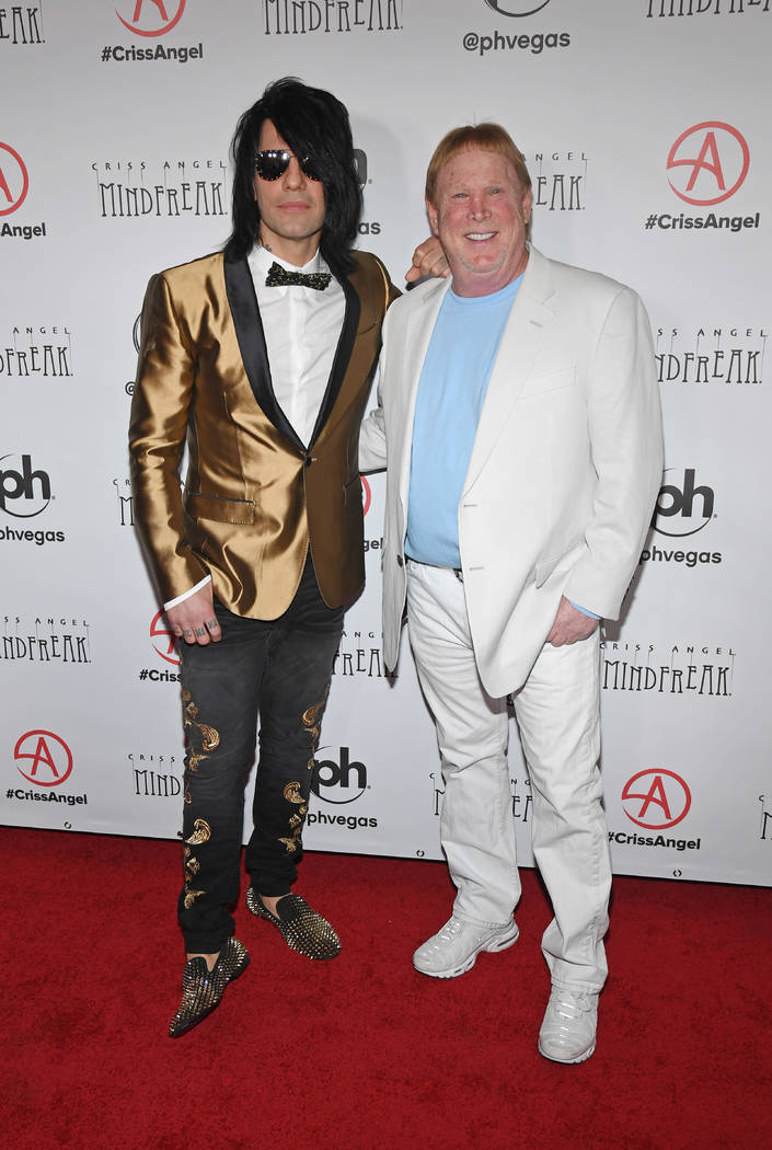 "Illusionist Criss Angel (L) and Oakland Raiders owner and managing general partner Mark Davis attend the grand opening of ""Criss Angel MINDFREAK"" at Planet Hollywood Resort & Casino on January 19, ..."