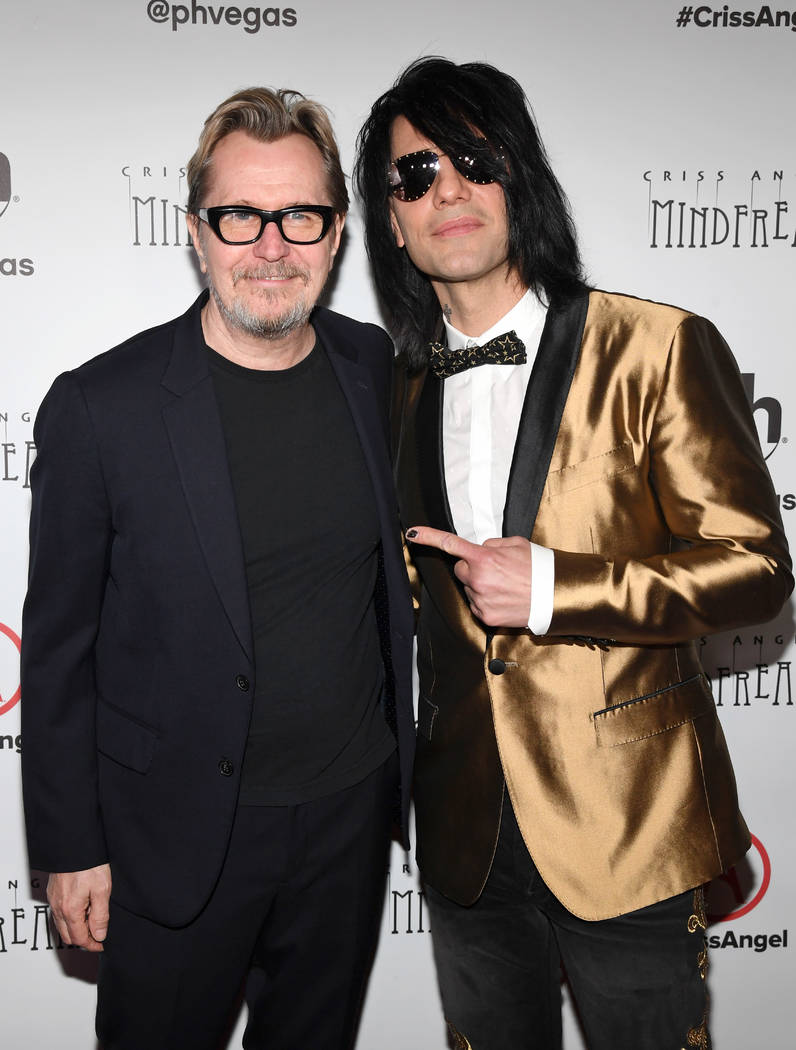 """Actor Gary Oldman (L) and illusionist Criss Angel attend the grand opening of """"Criss Angel MINDFREAK"""" at Planet Hollywood Resort & Casino on January 19, 2019 in Las Vegas, Nevada. (Photo by Ethan ..."""