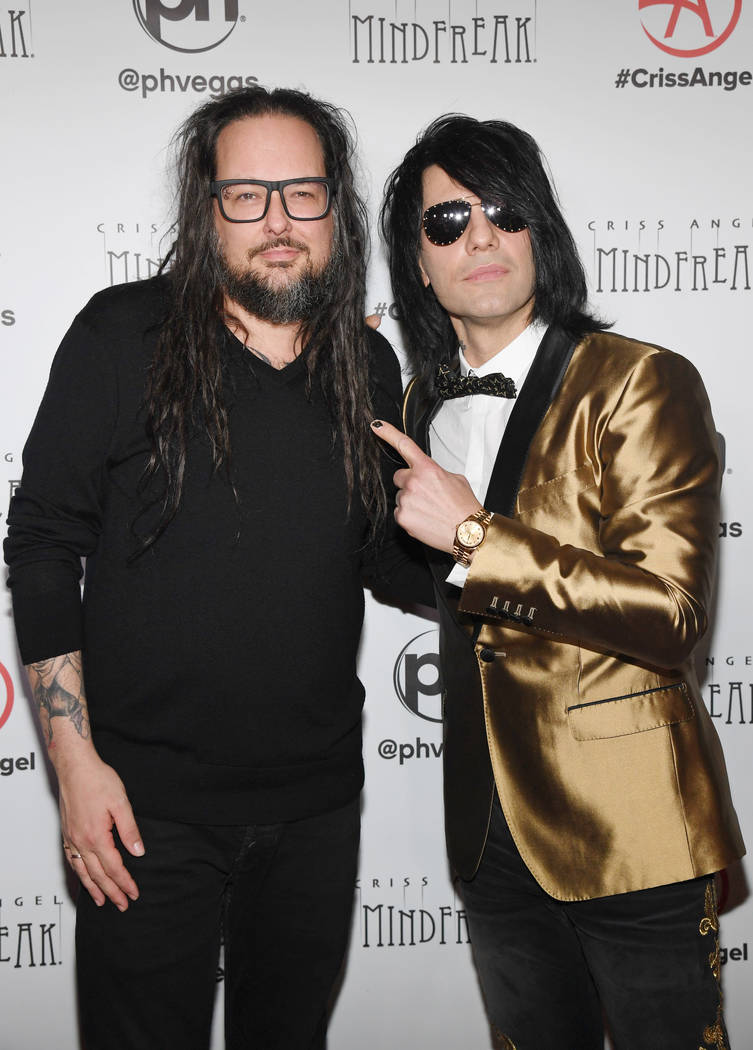 """Singer Jonathan Davis of Korn (L) and illusionist Criss Angel attend the grand opening of """"Criss Angel MINDFREAK"""" at Planet Hollywood Resort & Casino on January 19, 2019 in Las Vegas. (Photo by E ..."""