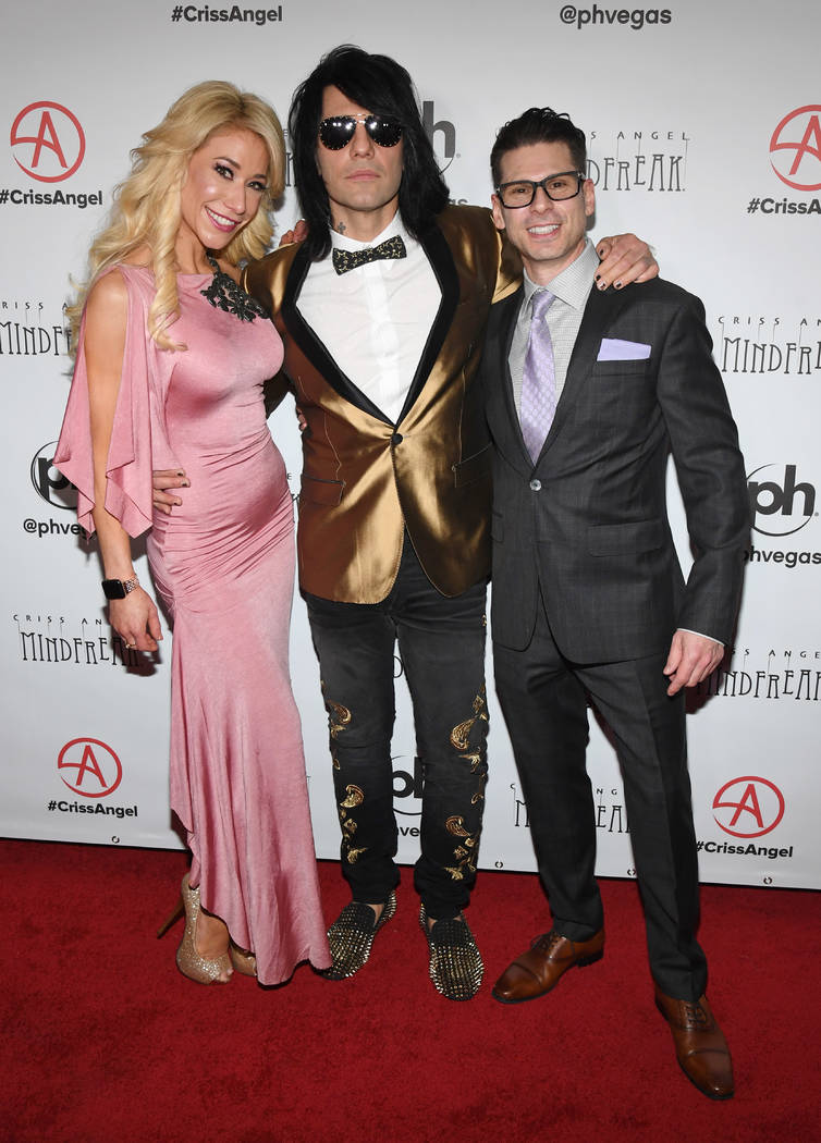 """(L-R) Violinist Lydia Ansel, illusionist Criss Angel and comedian/magician Mike Hammer attend the grand opening of """"Criss Angel MINDFREAK"""" at Planet Hollywood Resort & Casino on January 19, 2019 i ..."""