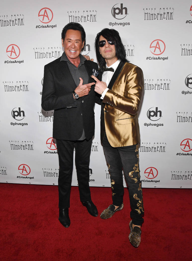 """Entertainer Wayne Newton (L) and illusionist Criss Angel attend the grand opening of """"Criss Angel MINDFREAK"""" at Planet Hollywood Resort & Casino on January 19, 2019 in Las Vegas. (Photo by Ethan ..."""