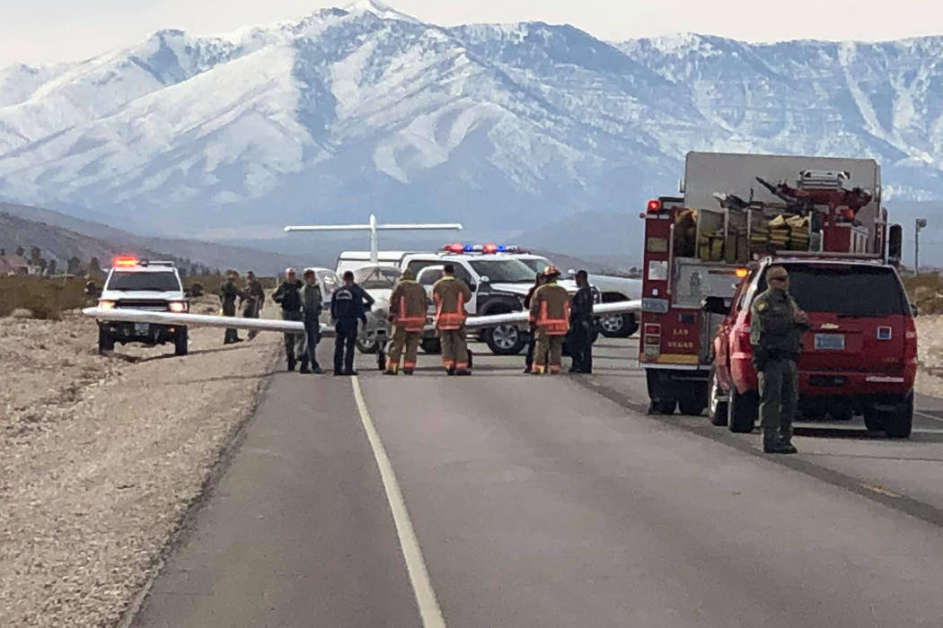 Law enforcement officers surround a plane that made an emergency landing on Kyle Canyon Road, near Las Vegas, on Sunday, Jan. 20, 2019. (Courtesy of Ciara Bergman)