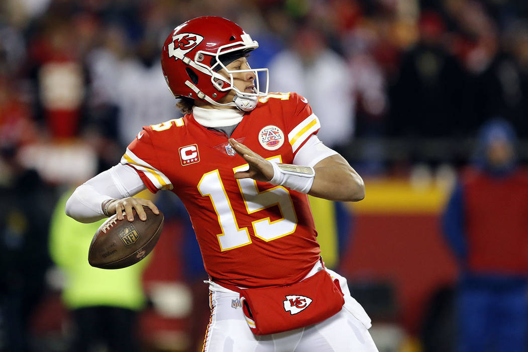Kansas City Chiefs quarterback Patrick Mahomes (15) throws a pass during the first half of the AFC Championship NFL football game against the New England Patriots, Sunday, Jan. 20, 2019, in Kansas ...