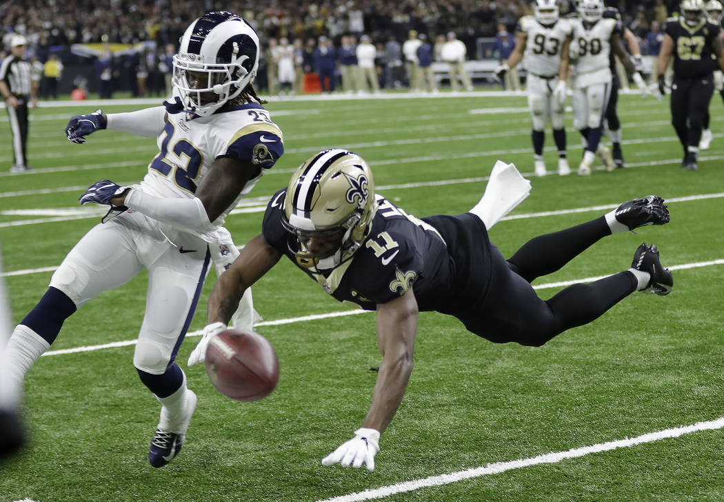 Los Angeles Rams' Nickell Robey-Coleman breaks up a pass intended for New Orleans Saints' Tommylee Lewis during the second half of the NFL football NFC championship game Sunday, Jan. 20, 2019, in ...