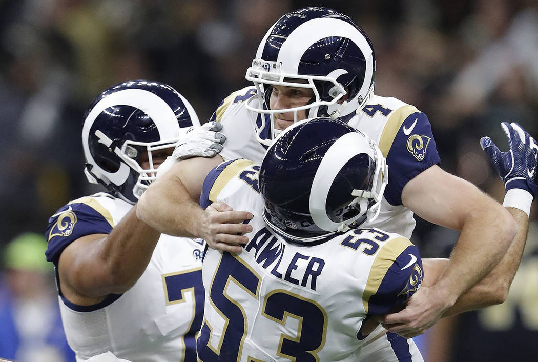 Los Angeles Rams' Greg Zuerlein is congratulated after making the game-winning field goal during overtime of the NFL football NFC championship game against the New Orleans Saints Sunday, Jan. 20, ...