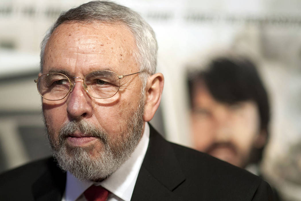 """Antonio """"Tony"""" Mendez, former CIA technical operations officer, poses for photographers at the premiere of the film Argo in Washington in October 2012. (AP Photo/Cliff Owen, File)"""