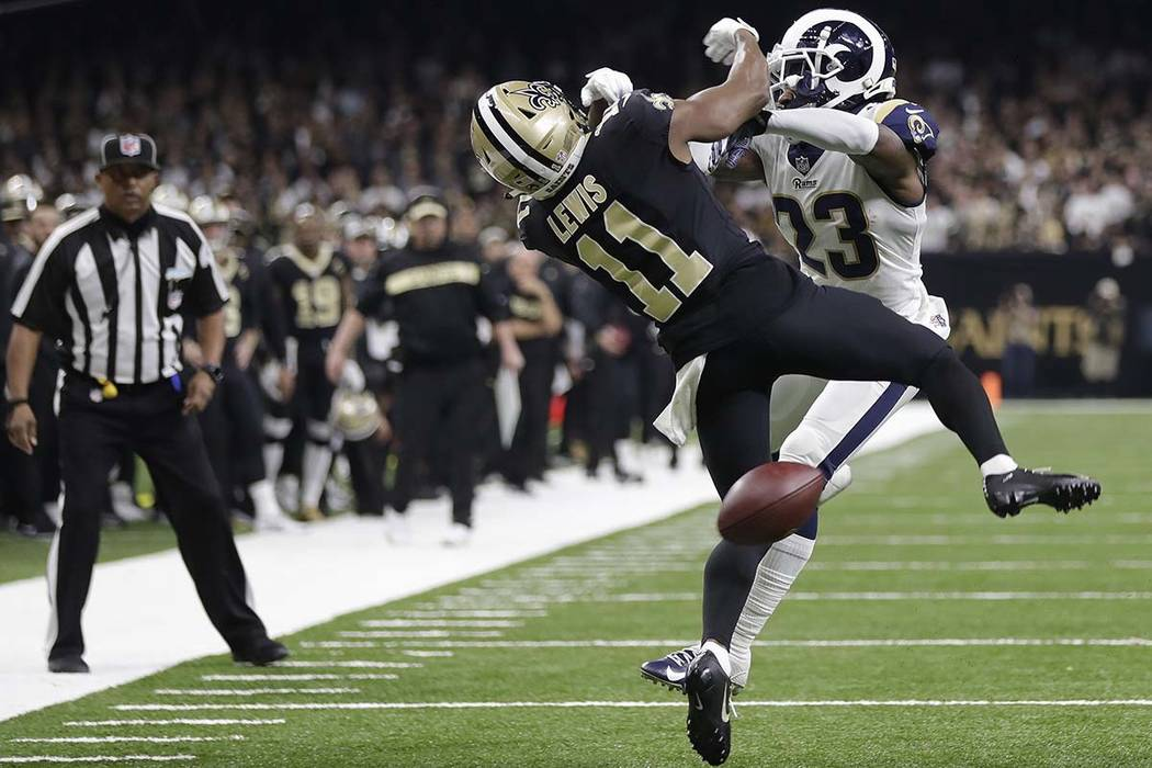 Los Angeles Rams defensive back Nickell Robey-Coleman interferes with New Orleans Saints wide receiver Tommylee Lewis (11) during the second half of the NFC Championship Game Sunday, Jan. 20, 2019 ...