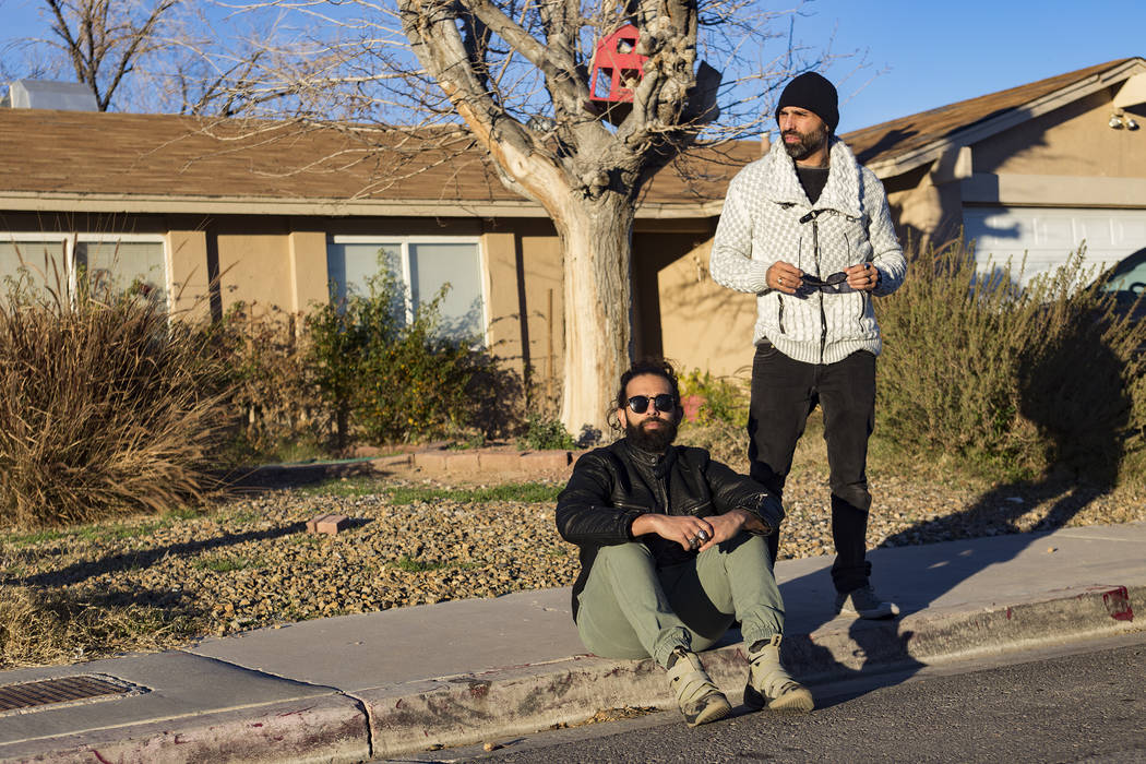 Ryan Patrick, left, and his brother Adrian Patrick, of the band Otherwise, outside their cousin Ivan's old house on the east side of Las Vegas, Tuesday, Jan. 22, 2019. They wrote a song with a vid ...