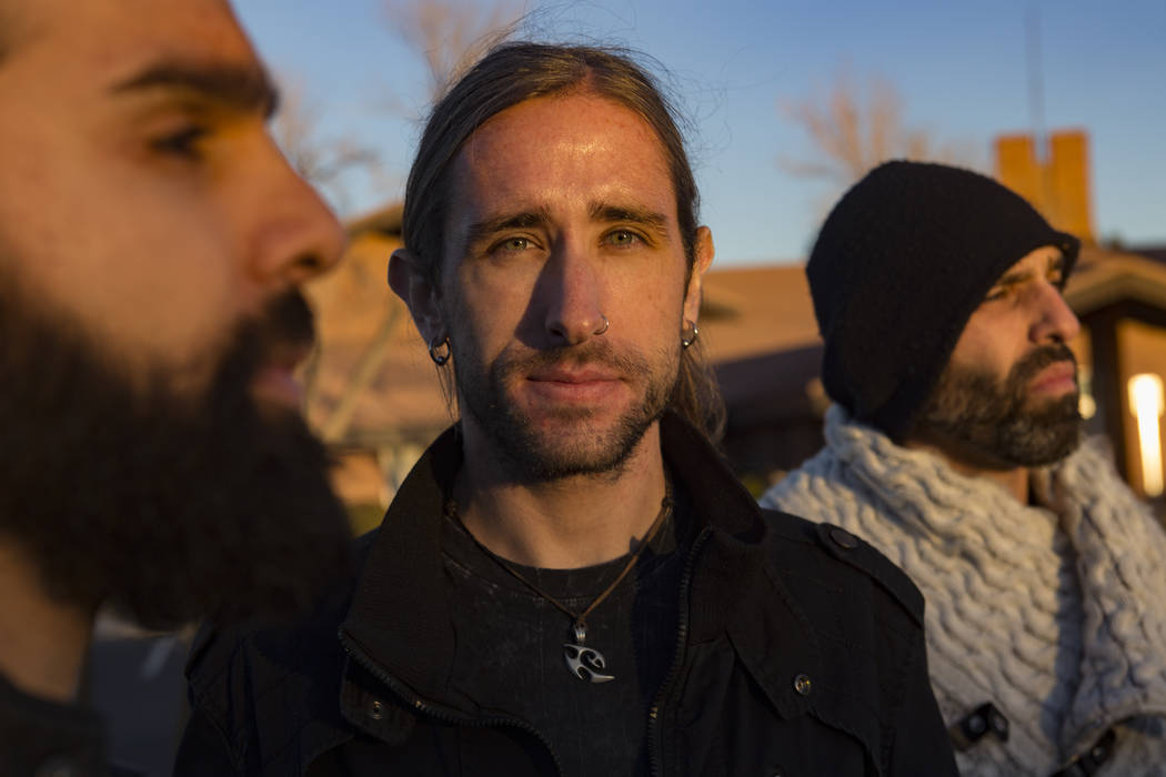 Ryan Patrick, from left, bandmate Brian Medeiros, and his brother Adrian Patrick, of the band Otherwise outside a church on the east side of Las Vegas, Tuesday, Jan. 22, 2019. The group wrote a so ...