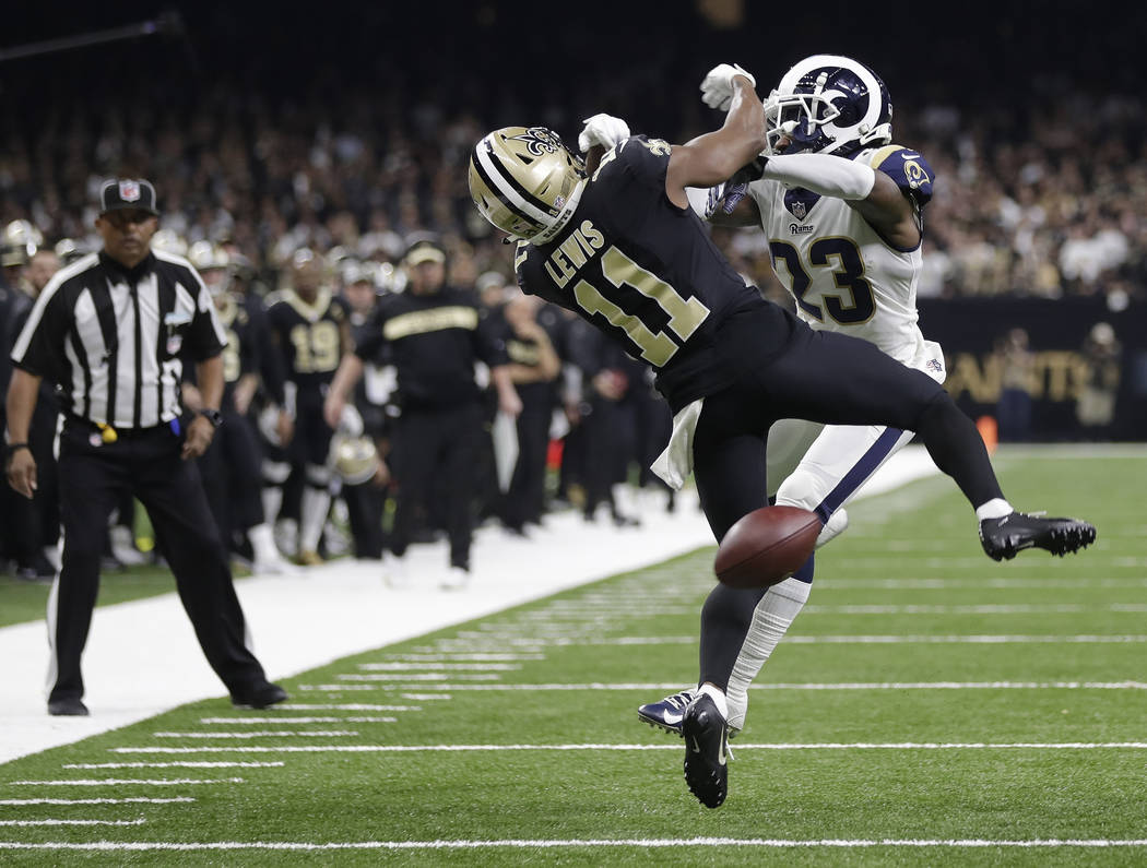 New Orleans Saints wide receiver Tommylee Lewis (11) works for a coach against Los Angeles Rams defensive back Nickell Robey-Coleman (23) during the second half the NFL football NFC championship g ...
