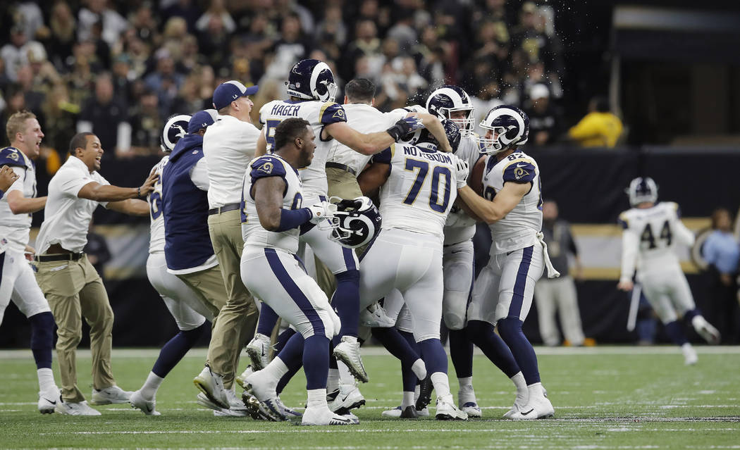 Los Angeles Rams celebrate after overtime of the NFL football NFC championship game against the New Orleans Saints, Sunday, Jan. 20, 2019, in New Orleans. The Rams won 26-23. (AP Photo/Carolyn Kaster)