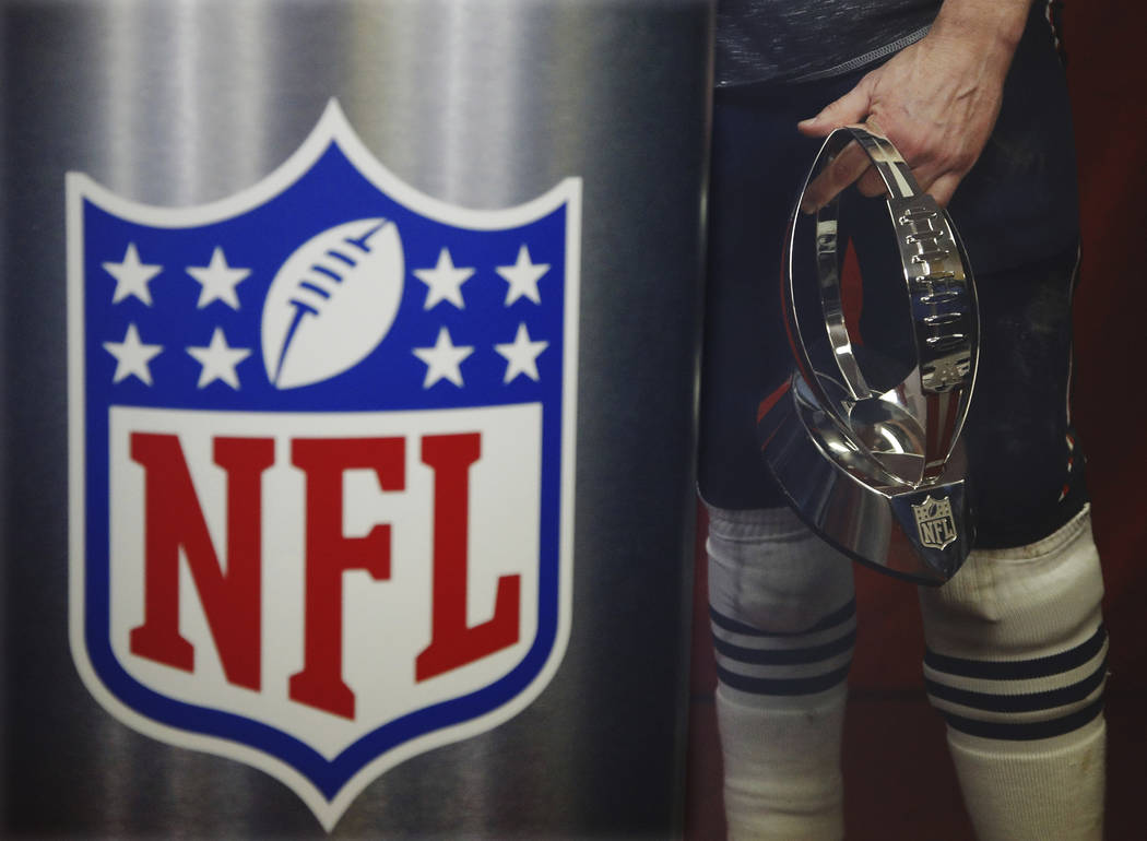 New England Patriots quarterback Tom Brady holds the championship trophy after the AFC Championship NFL football game against the Kansas City Chiefs, Sunday, Jan. 20, 2019, in Kansas City, Mo. (AP ...