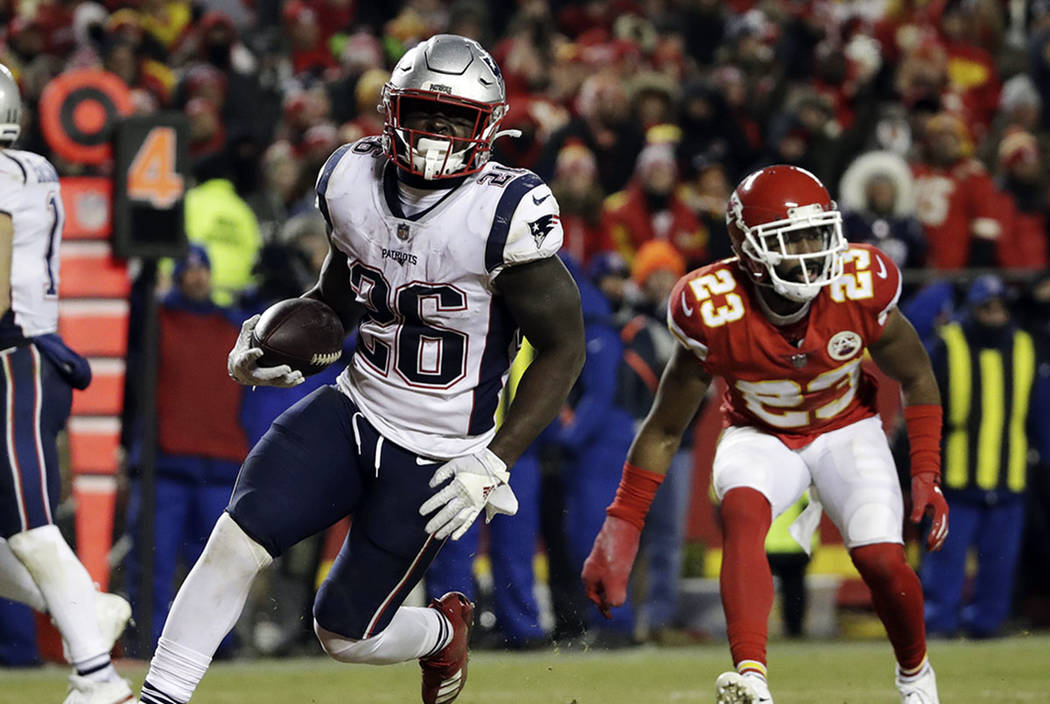 New England Patriots running back Sony Michel (26) runs to the end zone for a touchdown during the second half of the AFC Championship NFL football game against the Kansas City Chiefs, Sunday, Jan ...