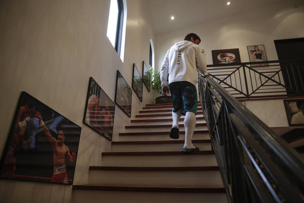 In this Jan. 14, 2019, file photo, boxer Manny Pacquiao walks up the steps to his bedroom for a nap following his morning run in Los Angeles. (AP Photo/Jae C. Hong, File, File)