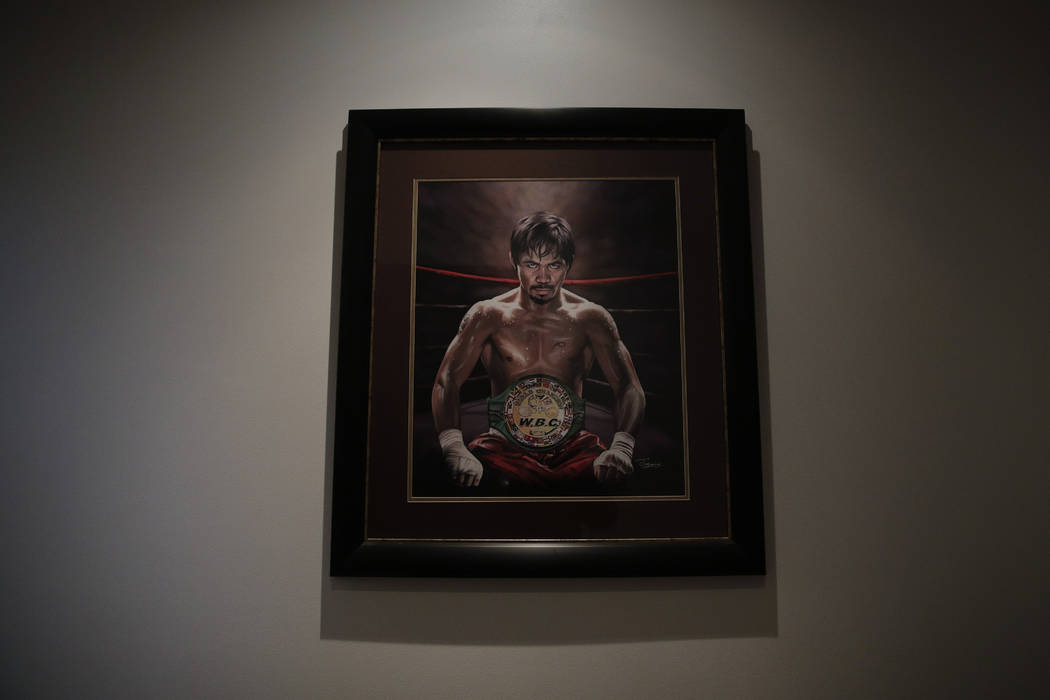 In this Jan. 14, 2019, file photo, a framed portrait of boxer Manny Pacquiao hangs in the foyer of his home in Los Angeles. (AP Photo/Jae C. Hong, File)