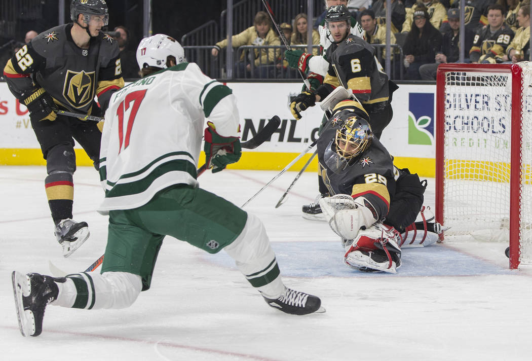 Minnesota Wild left wing Marcus Foligno (17) scores a goal against Golden Knights goaltender Marc-Andre Fleury (29) in the second period during their road matchup with Vegas on Monday, Jan. 21, 20 ...