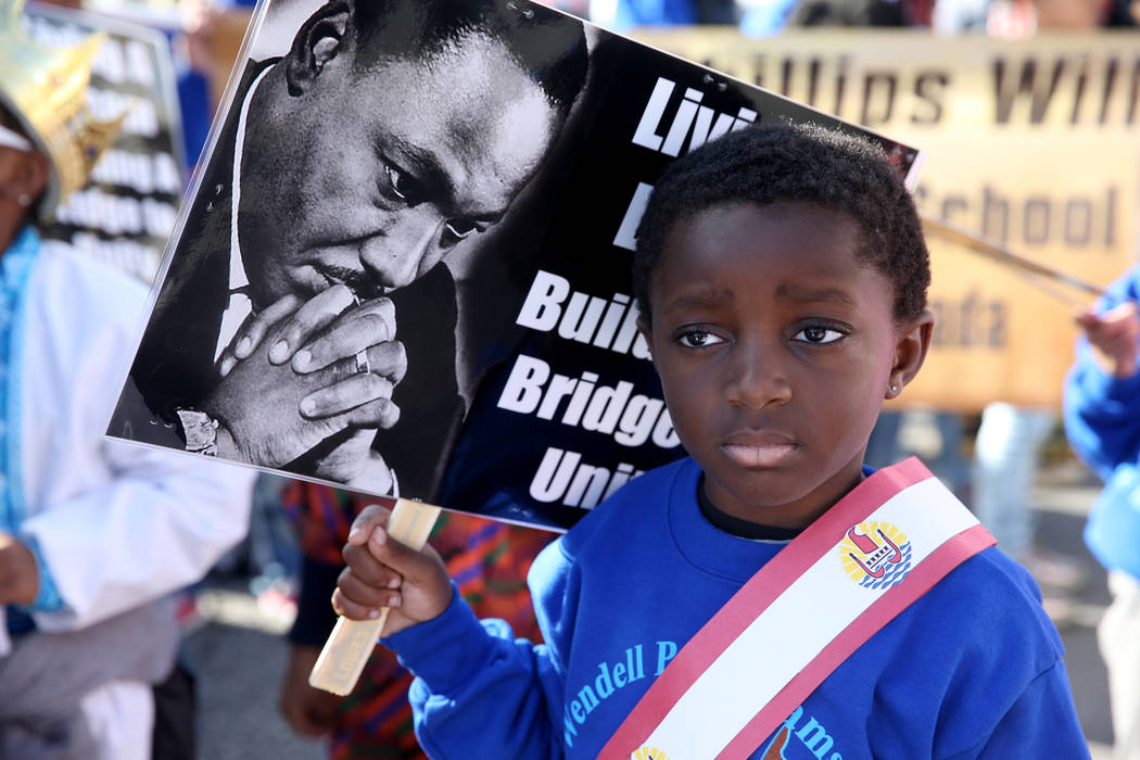 "Jayce Jordan, 4, prepares to march with the Williams Elementary school entry in the 37th Annual Dr. Martin Luther King, Jr. Parade, themed ""Living the Dream: One People, One Nation, One Dream ..."