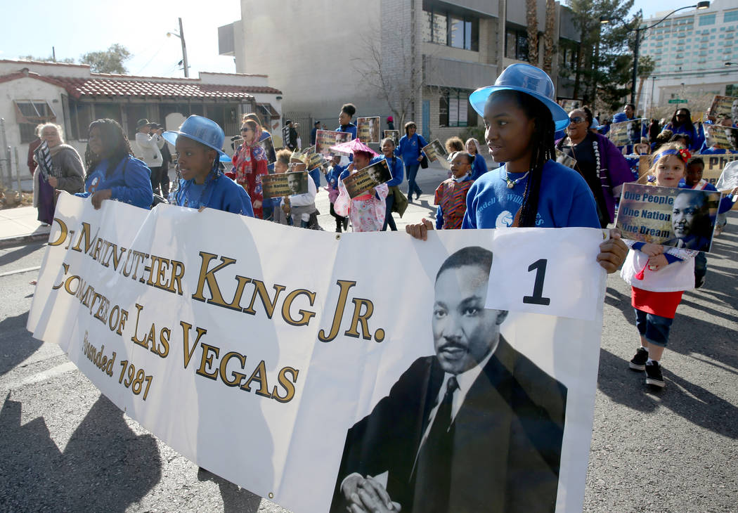 Fifth graders, from left, Tiara Greene, Samya Smith and Alyssa-Jade Carter, all 11, march with the Williams Elementary school entry in the 37th Annual Dr. Martin Luther King, Jr. Parade, themed &q ...