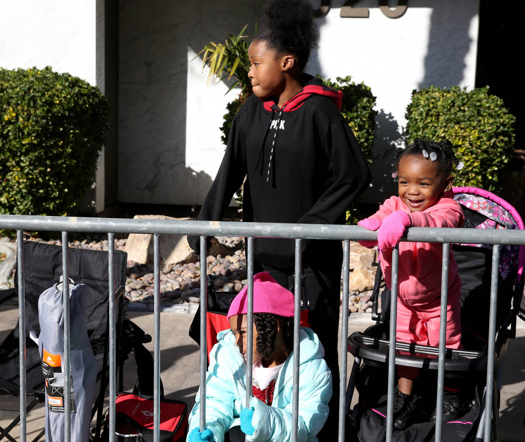 "Jalaya Reston, 12, Faith, 5, and Miann, 1, watch the 37th Annual Dr. Martin Luther King, Jr. Parade, themed ""Living the Dream: One People, One Nation, One Dream,"" in downtown Las Vegas ..."