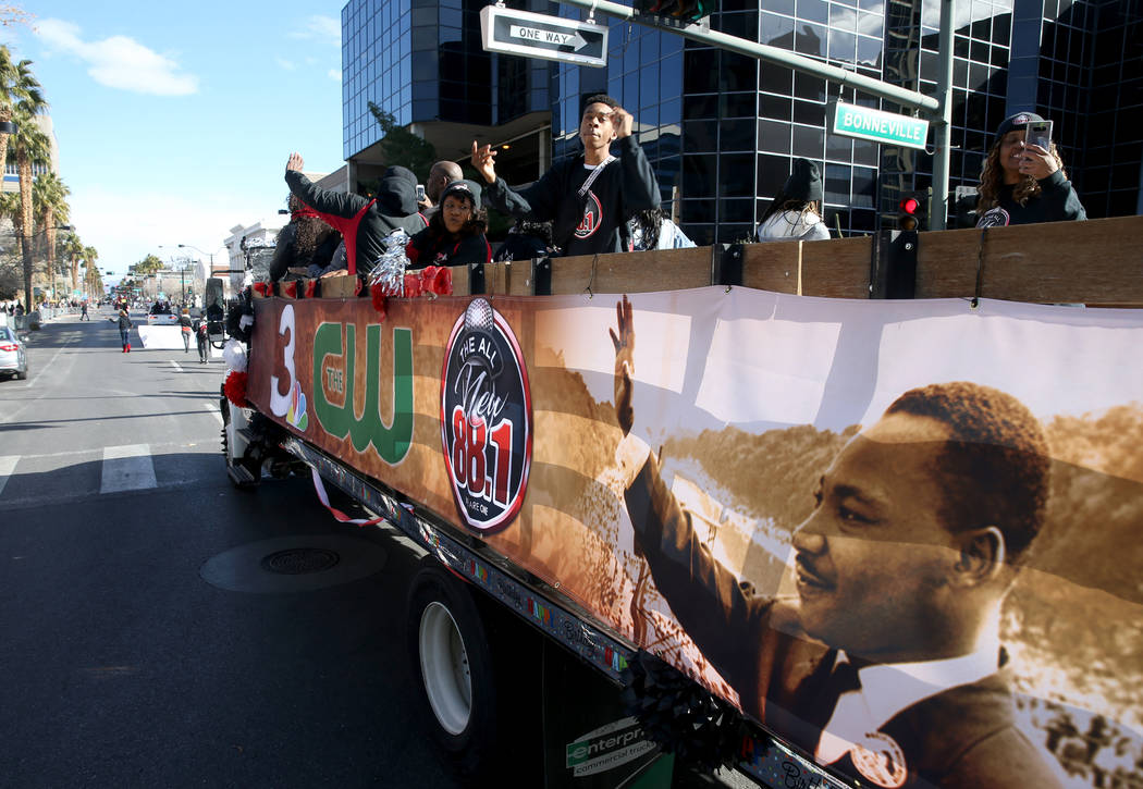"People dance in the KCEP Power 88 float during the 37th Annual Dr. Martin Luther King, Jr. Parade, themed ""Living the Dream: One People, One Nation, One Dream,"" in downtown Las Vegas Mon ..."