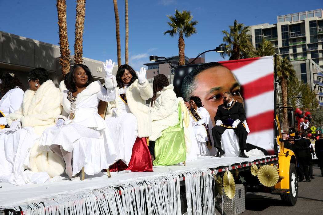 "People ride on the Desert Rose Grand Chapter Order of Eastern Star float in the 37th Annual Dr. Martin Luther King, Jr. Parade, themed ""Living the Dream: One People, One Nation, One Dream,&qu ..."