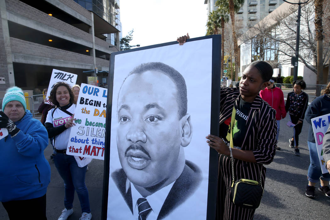 "Ashley Bowman, 25, marches with the Clark County Democratic Party entry in the 37th Annual Dr. Martin Luther King, Jr. Parade, themed ""Living the Dream: One People, One Nation, One Dream,&quo ..."