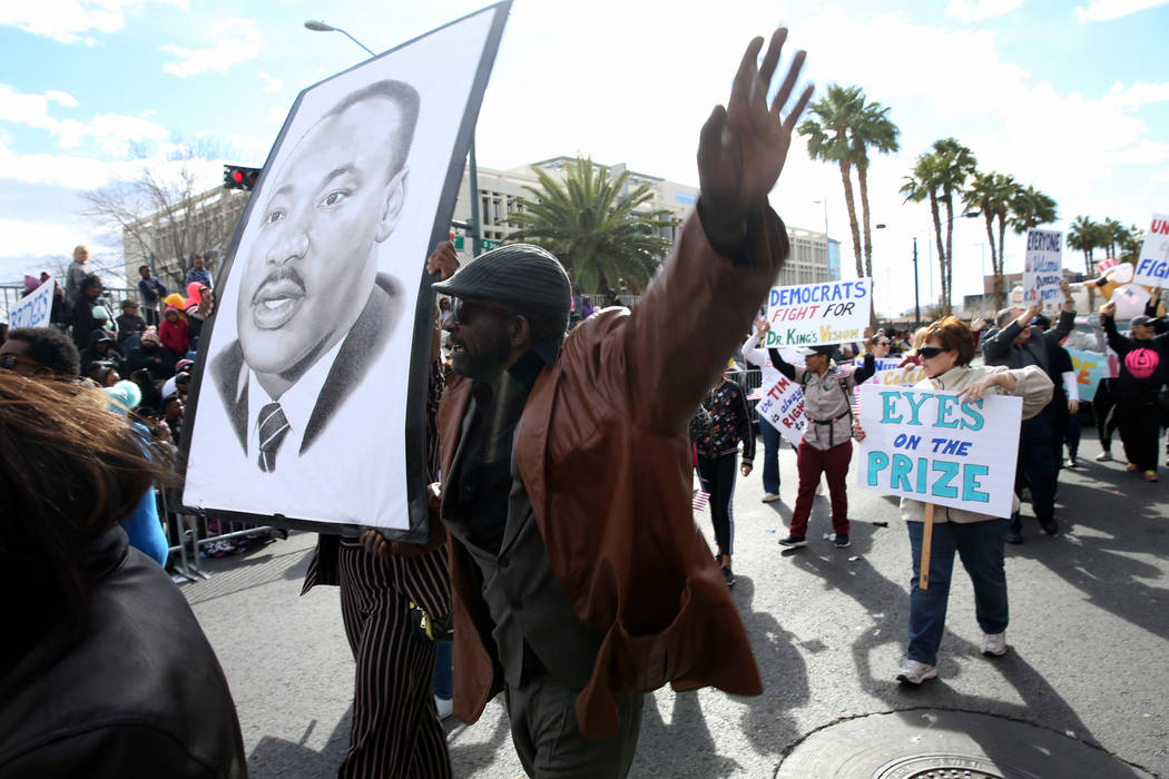 "Cornell McCrary, 61, of Las Vegas marches with the Clark County Democratic Party entry in the 37th Annual Dr. Martin Luther King, Jr. Parade, themed ""Living the Dream: One People, One Nation, ..."