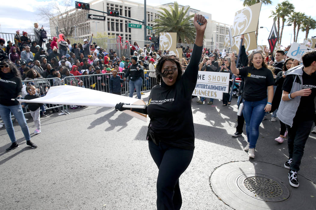 "Tammi Williams, 55, marches in the MGM Resorts International entry in the 37th Annual Dr. Martin Luther King, Jr. Parade, themed ""Living the Dream: One People, One Nation, One Dream,"" in ..."