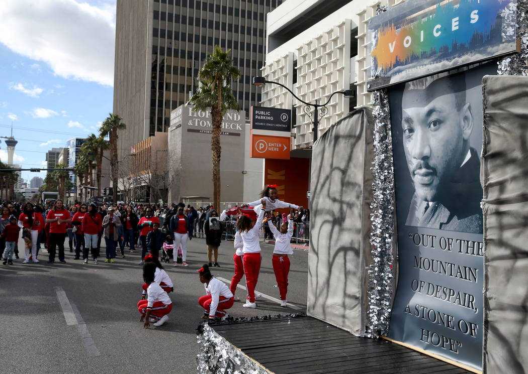 "VOICES, the Black Business Resource Group at Capital One float, in the 37th Annual Dr. Martin Luther King, Jr. Parade, themed ""Living the Dream: One People, One Nation, One Dream,"" in do ..."