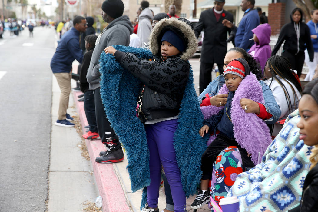 "Dasha Banks, 40 of Las Vegas bundles up her children Cyanna Lockett, 10, and Adrianna Lockett, 4, during the 37th Annual Dr. Martin Luther King, Jr. Parade, themed ""Living the Dream: One Peop ..."