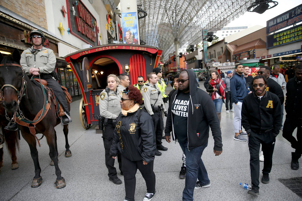 "Las Vegas police monitor the end of the 37th Annual Dr. Martin Luther King, Jr. Parade, themed ""Living the Dream: One People, One Nation, One Dream,"" in downtown Las Vegas Monday, Jan. 2 ..."