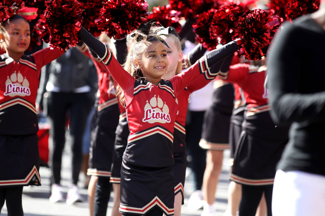 "Mila NcNealy, 9, and the Somerset Academy Lossee float in the 37th Annual Dr. Martin Luther King, Jr. Parade, themed ""Living the Dream: One People, One Nation, One Dream,"" in downtown La ..."
