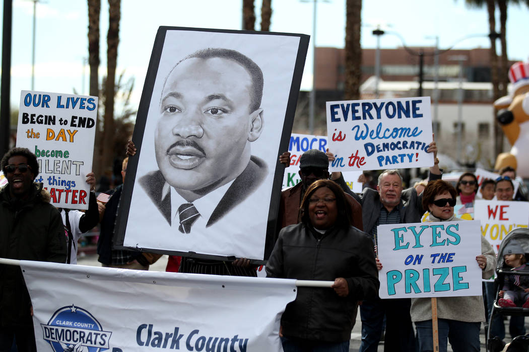 "The Clark County Democratic Party entry in the 37th Annual Dr. Martin Luther King, Jr. Parade, themed ""Living the Dream: One People, One Nation, One Dream,"" in downtown Las Vegas Monday, ..."