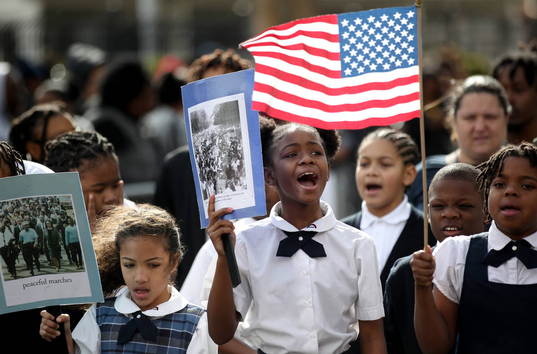 "Mirjhauni Jackson, 10, center in the 37th Annual Dr. Martin Luther King, Jr. Parade, themed ""Living the Dream: One People, One Nation, One Dream,"" in downtown Las Vegas Monday, Jan. 21, ..."