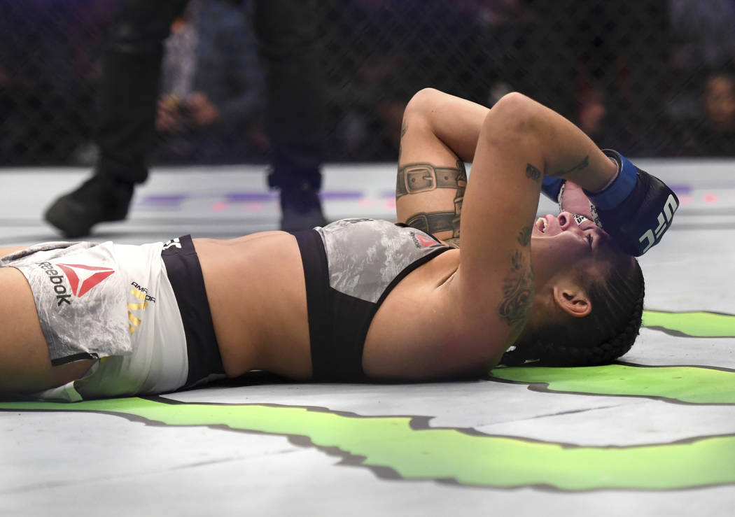 Amanda Nunes reacts after defeating Cris Cyborg after the UFC women's featherweight mixed martial arts bout at UFC 232, Saturday, Dec. 29, 2018, in Inglewood, Calif. (AP Photo/Kyusung Gong)
