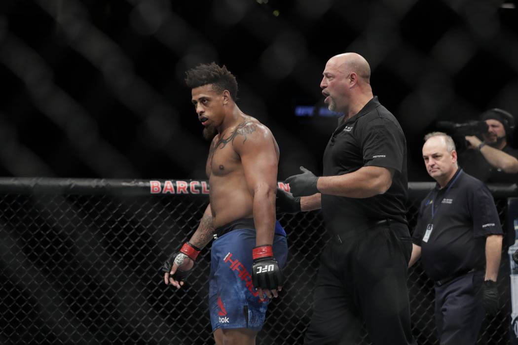 Greg Hardy is escorted by the referee after being disqualified during the second round of a heavyweight mixed martial arts bout against Allen Crowder at UFC Fight Night Sunday, Jan. 20, 2019, in N ...