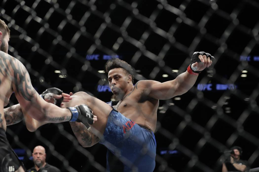 Greg Hardy kicks Allen Crowder during the first round of a heavyweight mixed martial arts bout at UFC Fight Night Saturday, Jan. 19, 2019, in New York. Crowder won the fight after Hardy was disqua ...