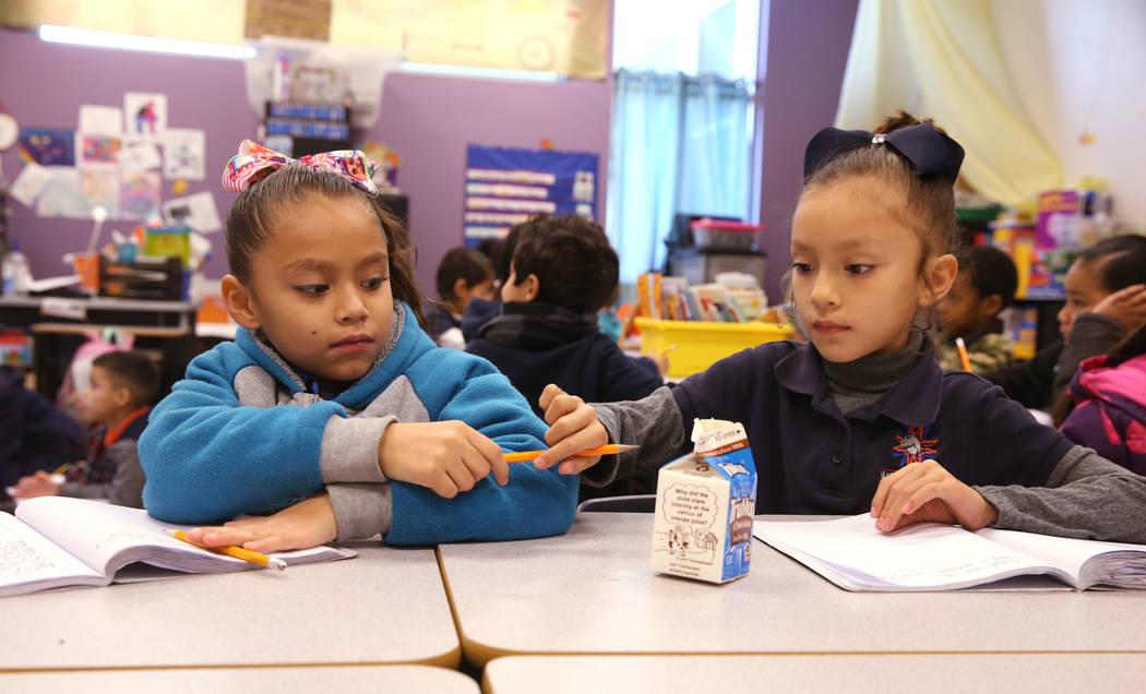 E'liana Trujillo borrows a pencil from Maryah Villezcas in Shamika Abbott's first grade class at Mater Academy Mountain Vista charter school in Las Vegas Wednesday, Jan. 16, 2019. K.M. Cannon Las ...