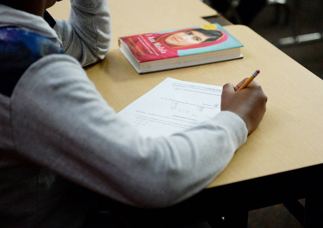 A sixth grade student writes down math problems during class at Democracy Prep in Las Vegas, Tuesday, Jan. 22, 2019. Caroline Brehman/Las Vegas Review-Journal