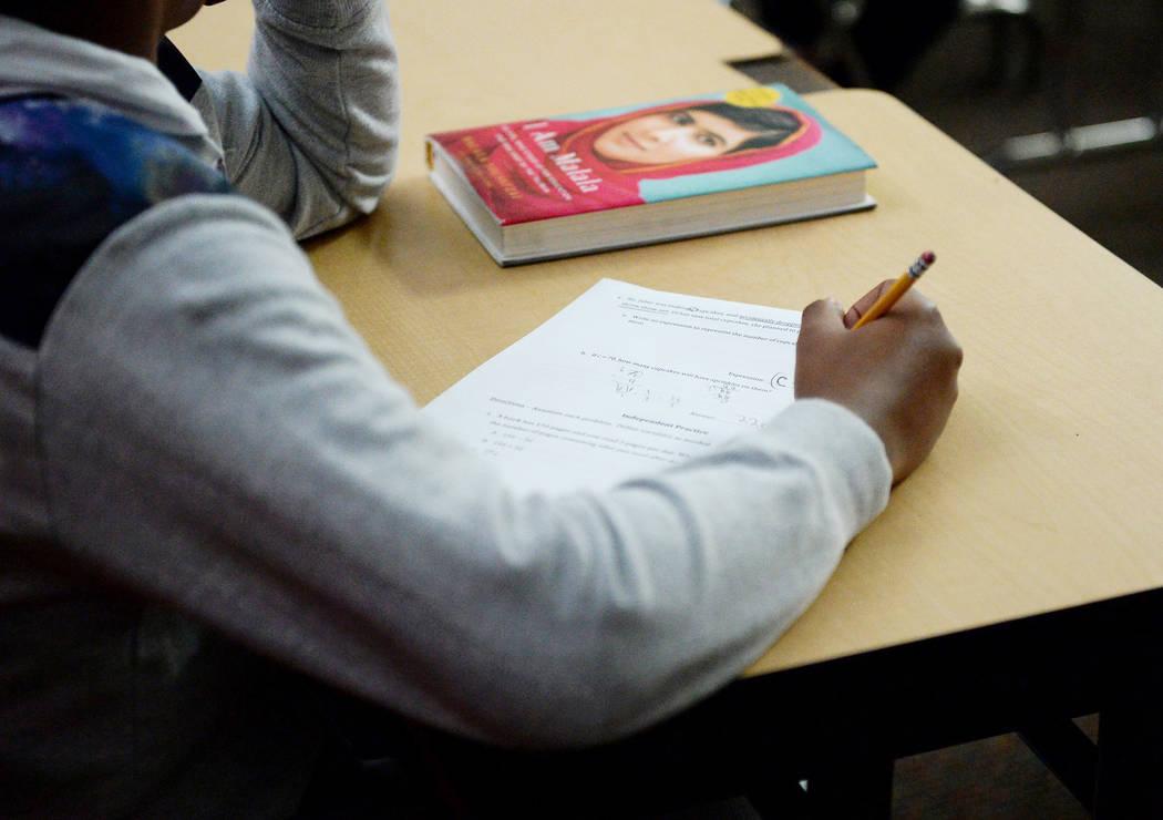 A sixth grade student writes down math problems during class at Democracy Prep in Las Vegas, Tuesday, Jan. 22, 2019. Caroline Brehman/Las Vegas Review-Journal
