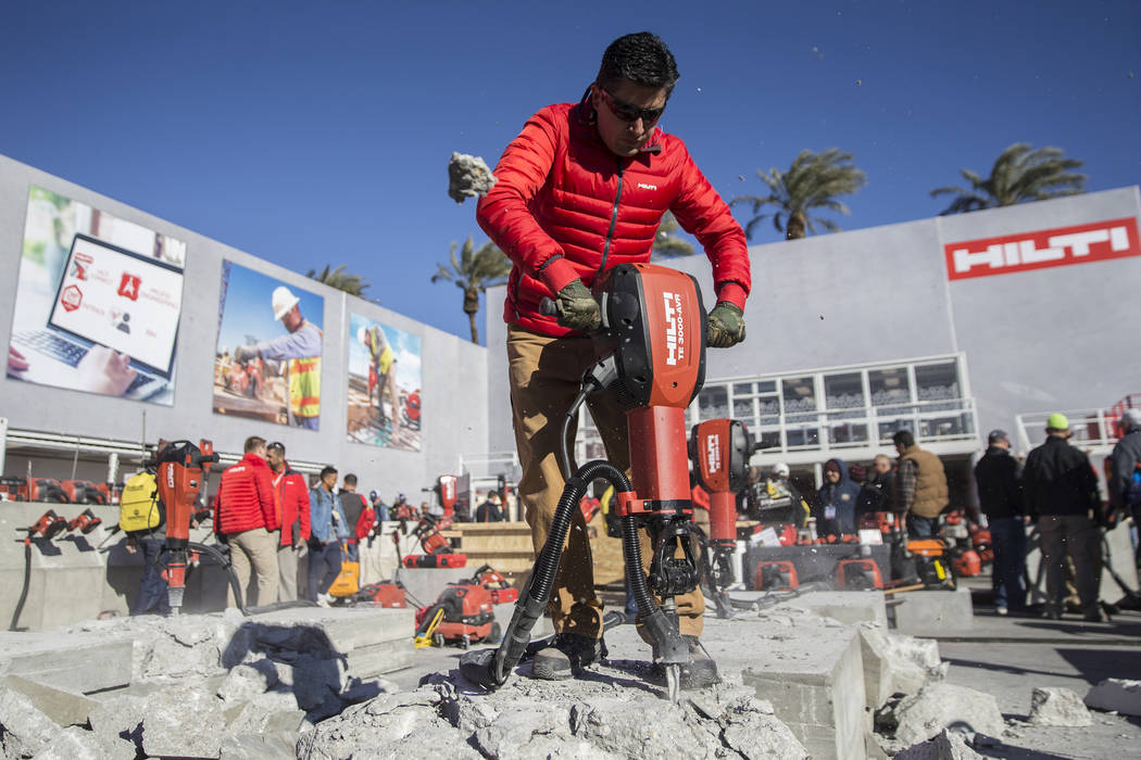 Carlos Beltran, with Hilti INC., demonstrates a heavy electric breaker during the first day of the World of Concrete on Tuesday, Jan. 22, 2019, at the Las Vegas Convention Center, in Las Vegas. (B ...