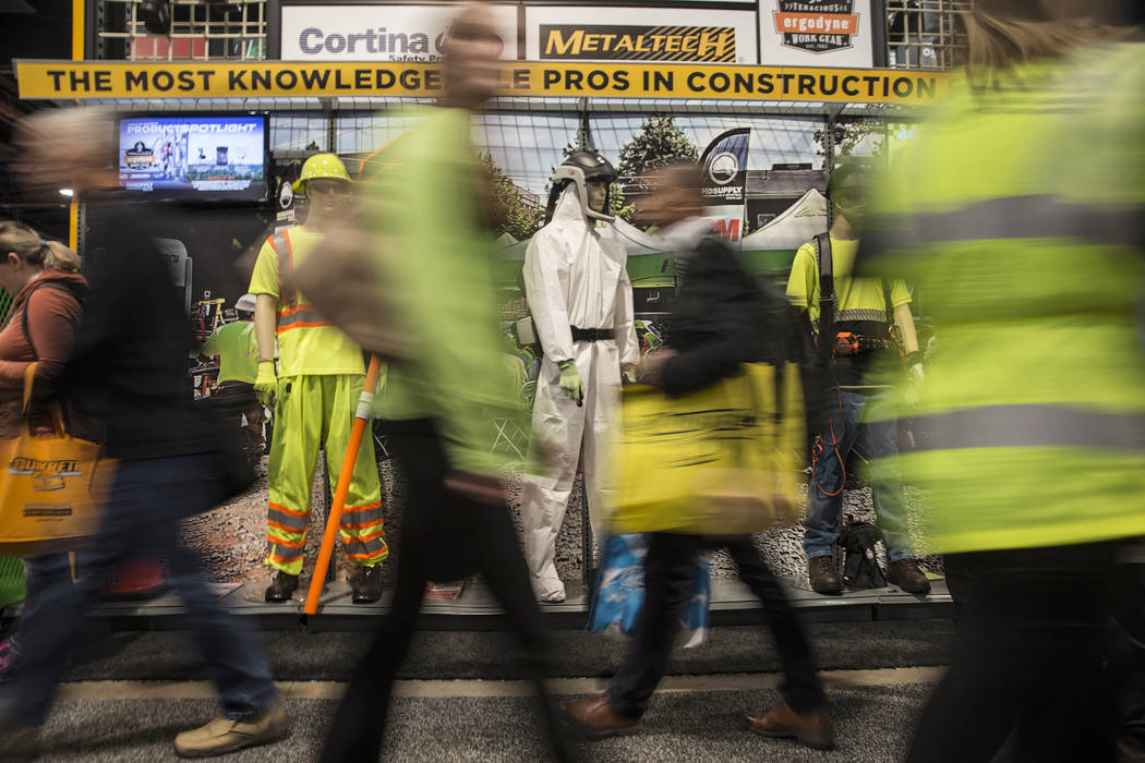 Convention goers walk past a Metaltech booth during the first day of the World of Concrete on Tuesday, Jan. 22, 2019, at the Las Vegas Convention Center, in Las Vegas. (Benjamin Hager/Las Vegas Re ...
