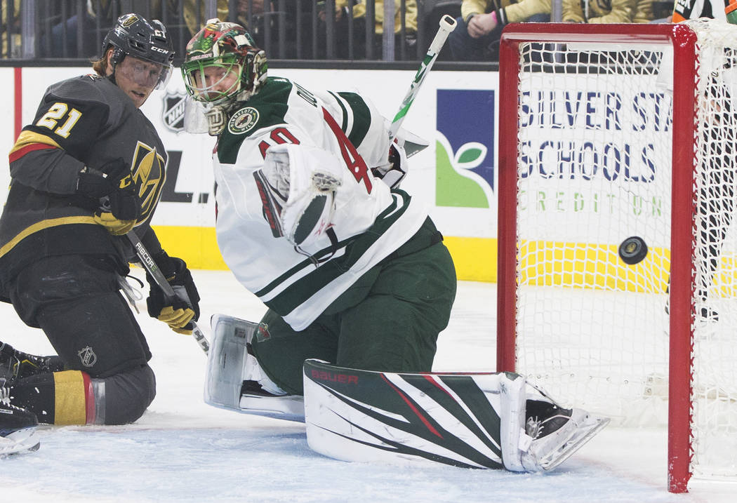 Minnesota Wild goaltender Devan Dubnyk (40) makes a save against Golden Knights center Cody Eakin (21) in the first period on Monday, Jan. 21, 2019, at T-Mobile Arena, in Las Vegas. (Benjamin Hage ...