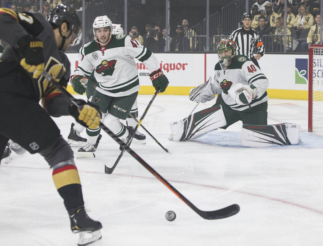Golden Knights left wing Max Pacioretty (67) shoots against Minnesota Wild goaltender Devan Dubnyk (40) in the first period on Monday, Jan. 21, 2019, at T-Mobile Arena, in Las Vegas. (Benjamin Hag ...